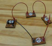 3 small bulbs are connected in series to a 9-V battery