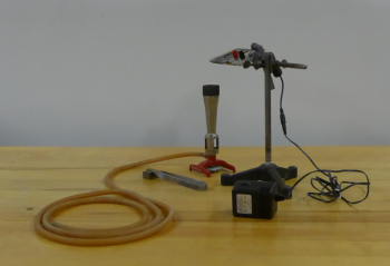 Light bulb with wires on ring stand, bunsen burner, striker