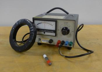 A coil of wire, an analog voltmeter, and a small magnet