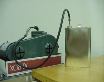A vacuum pump and a paint can