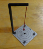 Chaos pendulum rests on a table