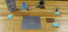 Assorted capacitors and masses and a metal plate