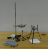 Flask of water, bunsen burner, stand for boiling, ice cubes, gloves