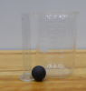 A 50-mL graduated cylinder, a 2000-mL beaker, and a black rubber ball