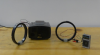 2 coils of wire, a speaker, and a hand-held radio
