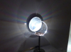A bubble in front of a CENCO lamp produces a colorful array