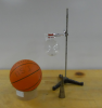 A basketball, a round flask with ball bearing (mounted), and a metal cone