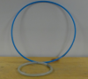 A large blue hoola hoop and a smaller ring