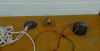 Electromagnet, Iron plate connected to ropes, 9V battery lay on a table