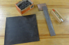 A magnet, a box of nails, and pieces of rubber, glass, plastic, iron, and copper