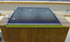 3 pucks rest on an air table