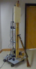 Dart gun rests against apparatus