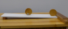 Two wooden disks on an angled ramp