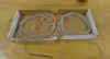 A long tube is coiled inside of a box.