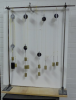 4 separate pulleys hang from a horizontal rod.