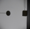 Shadow of a ball in circular motion and a cube in vertical oscillation projected onto a whiteboard