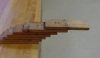 7 boards stacked in an arch formation