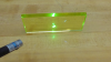 Uranium glass fluoresces in the presence of violet and UV light