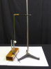 A ball on a string hangs vertically next to a tuning fork connected to a resonating box